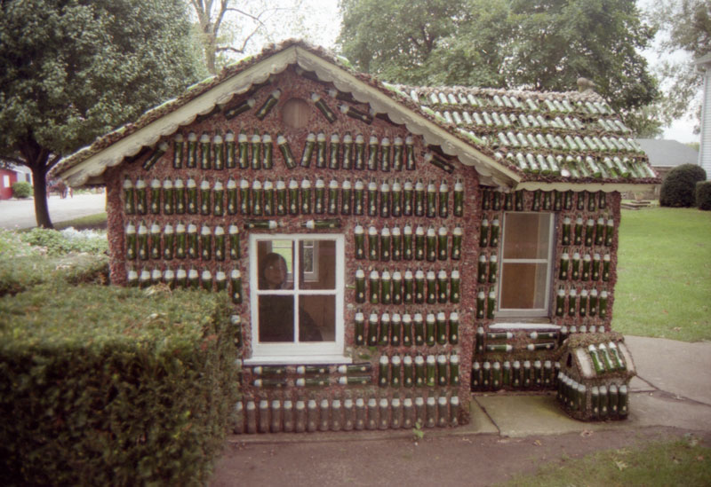 The Fresca Bottle House Incorporated Nearly 2400 Fresca Bottles In Its  Construction. It Is A Cute Little Playhouse With Tiny Chairs And Table  Inside.
